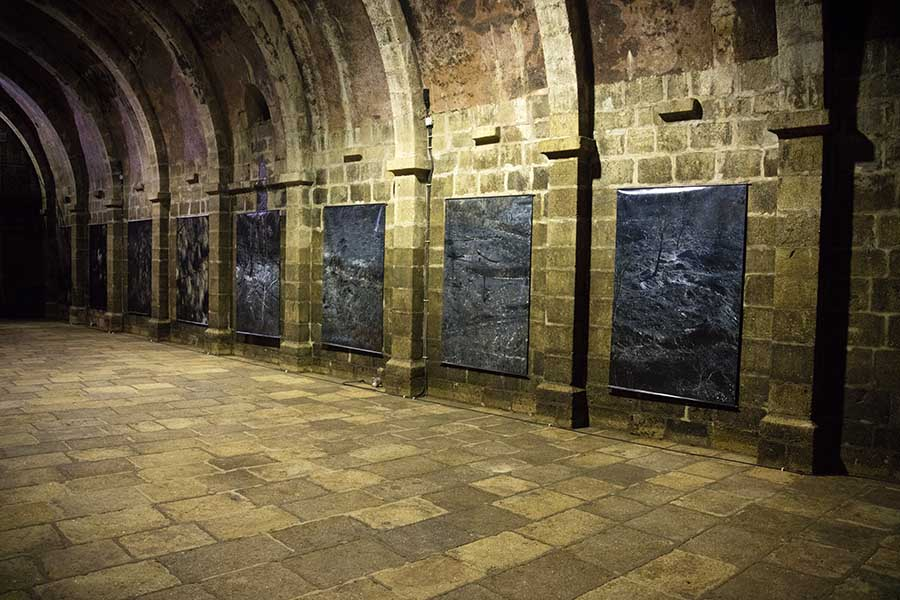 Photo of the All Precious Is Defenceless exhibition _the burnt forest in the Constancia 2013 fire photo's_ in the cistern of the Marvão Castle', 2016, Portugal.